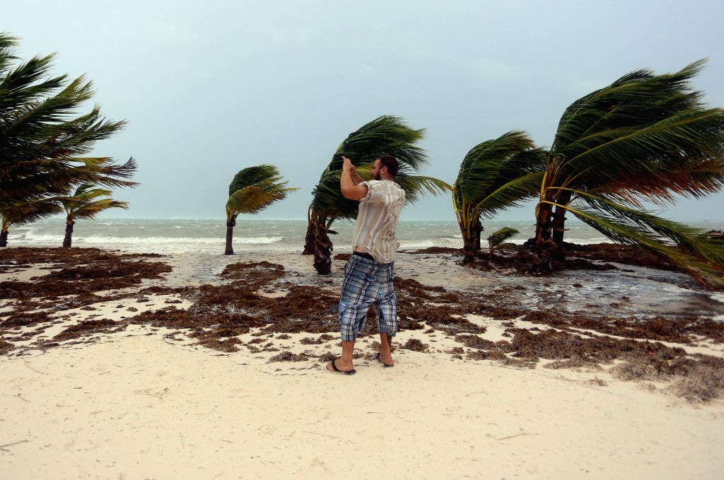 PUNTA CANA (DOMINICAN REPUBLIC), Sept. 21, 2017 (Xinhua) -- Image taken on Sept. 20, 2017 shows a tourist taking pictures during the passing of Hurricane Maria in Punta Cana, Dominican Republic. Roosevelt Skerrit, Prime Minister of Dominica confirmed