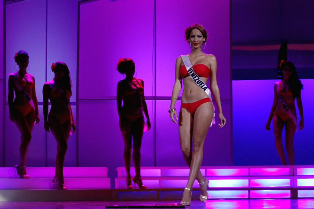 Venezuela's candidate Vicmary Rivero (Front) poses in bathing suit during the World's Miss Latin America 2014 contest, in Punta Cana City, Dominican Republic, on