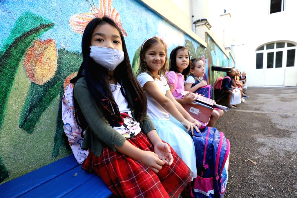 Pupils arrive at the campus of a primary school on the first day of the new school year in Nice, southern France, Sept. 1, 2020. The new school year kicked off on ...