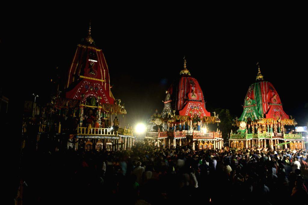 Puri: Chariots of Lord Jagannath and his siblings Lord Balabhadra and Devi Subhadra during the annual nine-day Jagannath Rath Yatra in Odisha's Puri (Photo: IANS)
