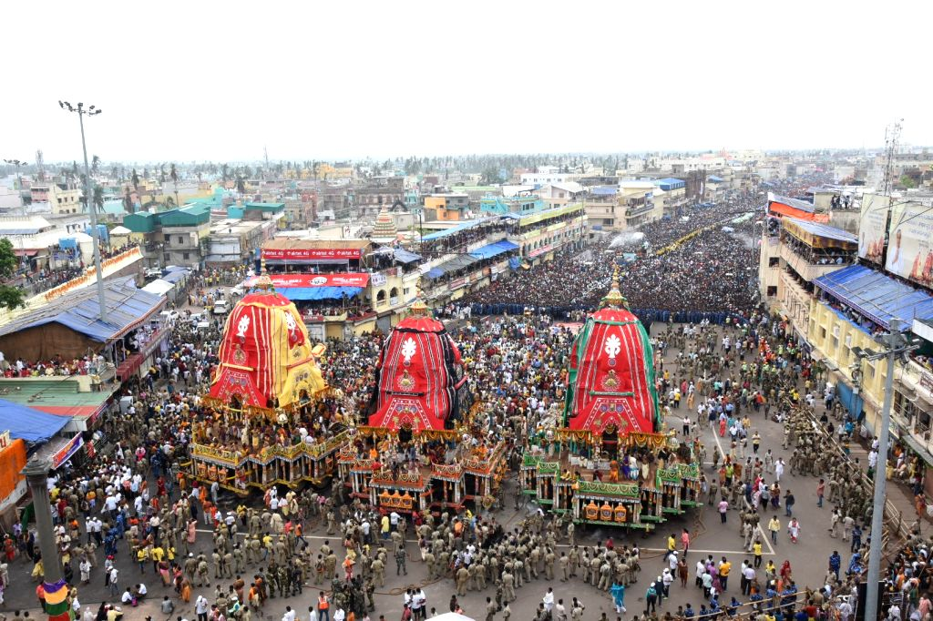 Puri: Devotees throng Bada Danda (Grand Road) from where Lord Jagannath and his siblings Lord Balabhadra and Devi Subhadra will travel to the Shree Gundicha temple, as the annual nine-day Jagannath Rath Yatra begins, in Odisha's Puri on July 4, 2019.