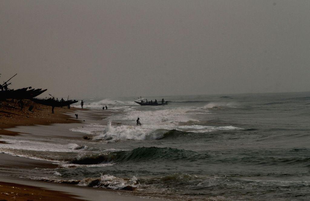 Puri: Fishing boats anchored on Puri beach amidst cyclonic storm Kyant alert on Oct 26, 2016. (Photo: IANS)