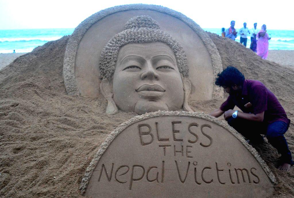 Indian sand artist Sudarsan Pattnaik's creation on the eve of Buddha Purnima at the Puri beach, Odisha on May 3, 2015. - Sudarsan Pattnai