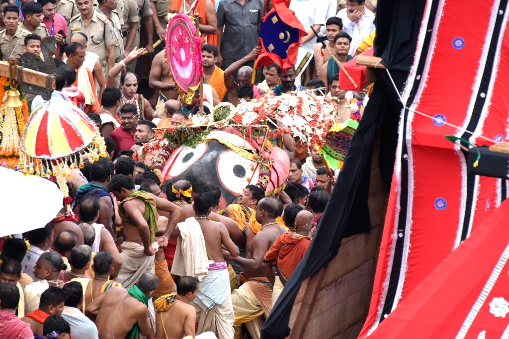 Puri: Lord Jagannath's idol being taken to be placed in a chariot as the annual nine-day Rath Yatra of Lord Jagannath and his siblings - Lord Balabhadra and Devi Subhadra begins, in Odisha's Puri on July 4, 2019. (Photo: IANS)