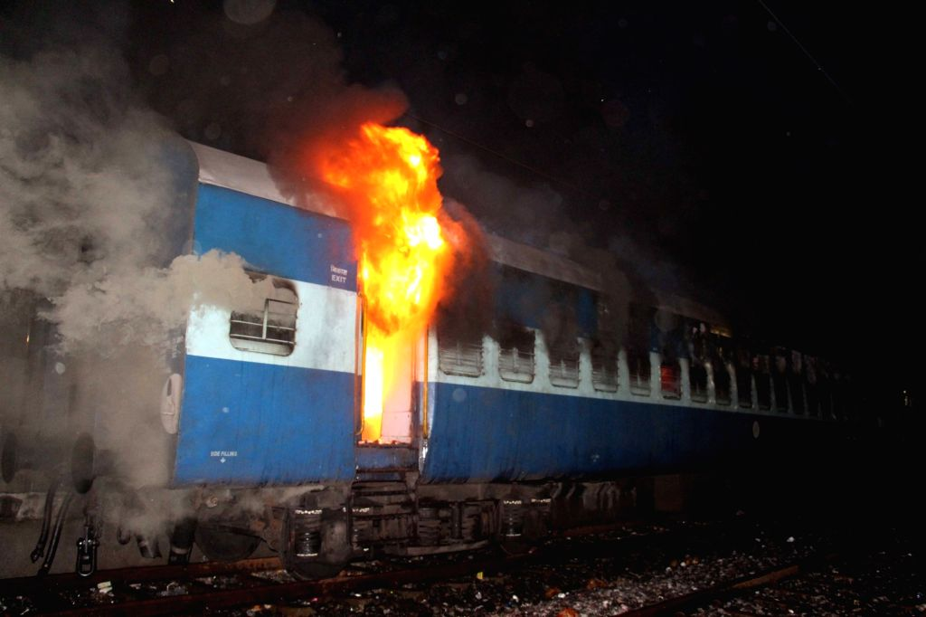 : Puri: One of the three trains that caught fire at at Puri railway station on Nov 12, 2015. (Photo: IANS).