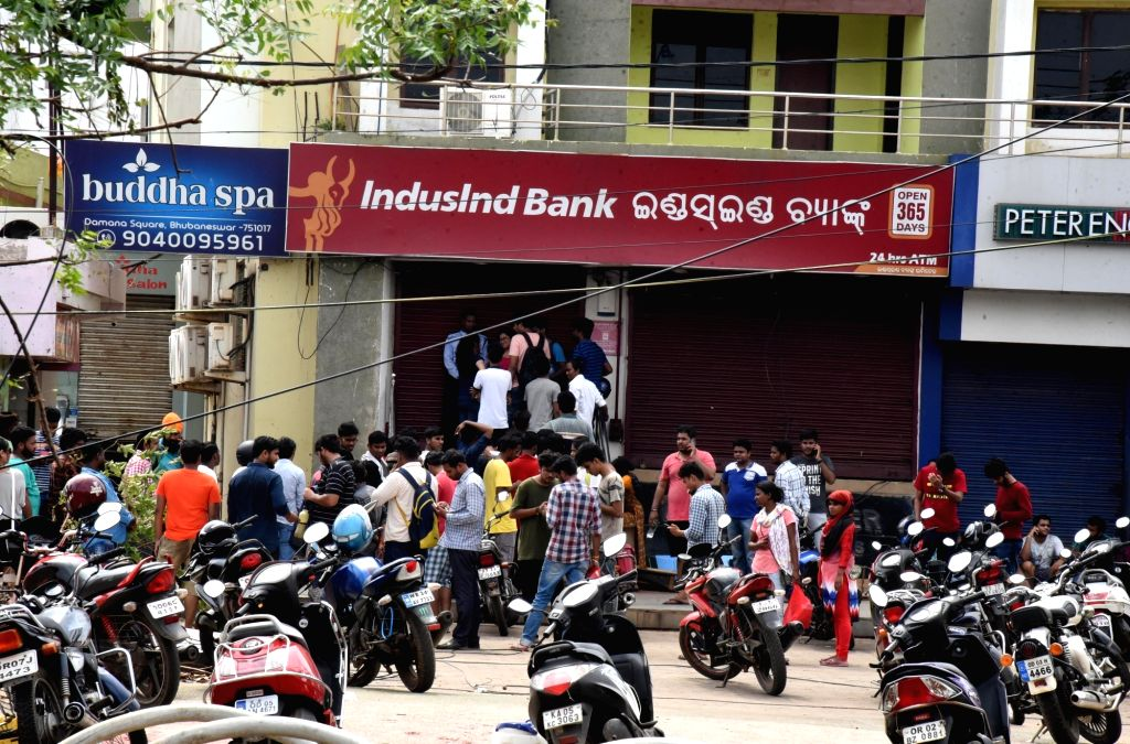Puri: People queue-up outside an ATM in Puri on May 6, 2019. (Photo: IANS)