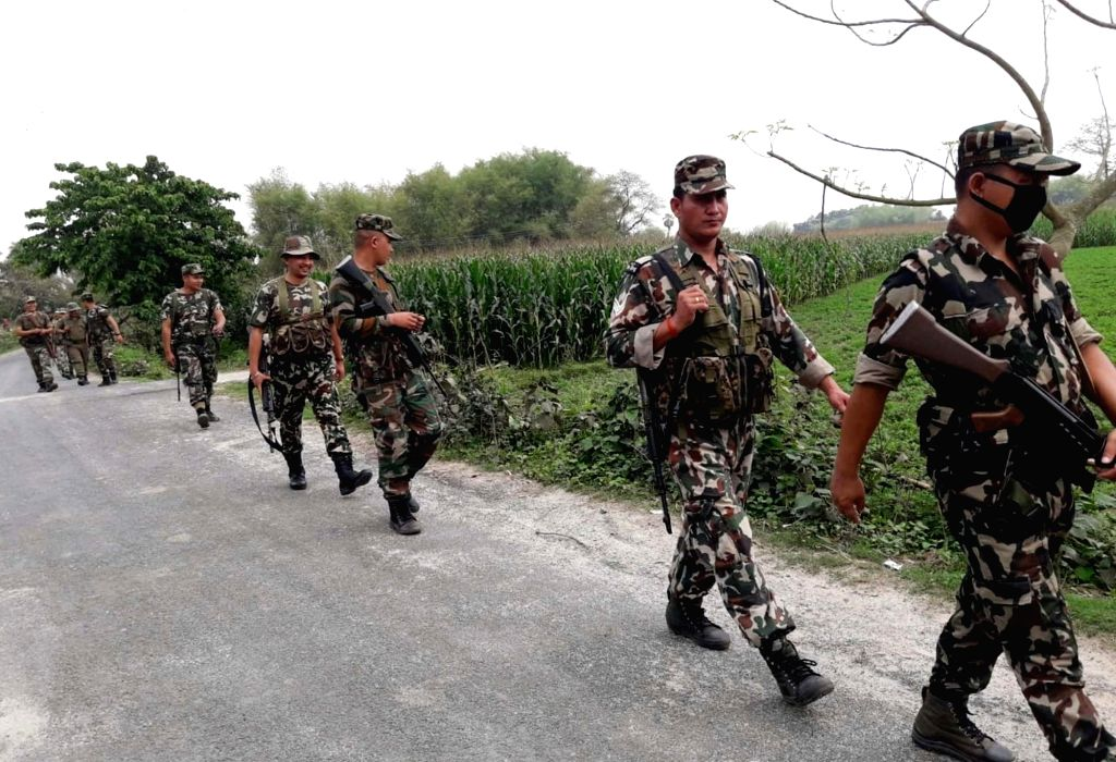 Purnea: Border Security Force (BSF) personnel conduct a flag march along the Indo-Nepal border ahead of the 2019 Lok Sabha elections, in Bihar's Purnia, on April 15, 2019. (Photo: IANS)