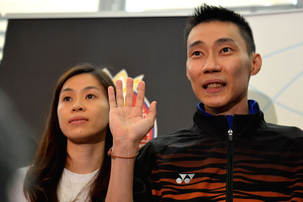 PUTRAJAYA, June 13, 2019 - Malaysia's badminton player Lee Chong Wei (R) reacts during a news conference to announce his retirement in Putrajaya, Malaysia, June 13, 2019.