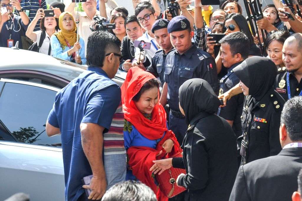 PUTRAJAYA, June 5, 2018 - Rosmah Mansor (C), wife of former Malaysian Prime Minister Najib Razak, arrives at the headquarters of the Malaysian Anti-Corruption Commission (MACC) to be questioned by ... - Najib Razak