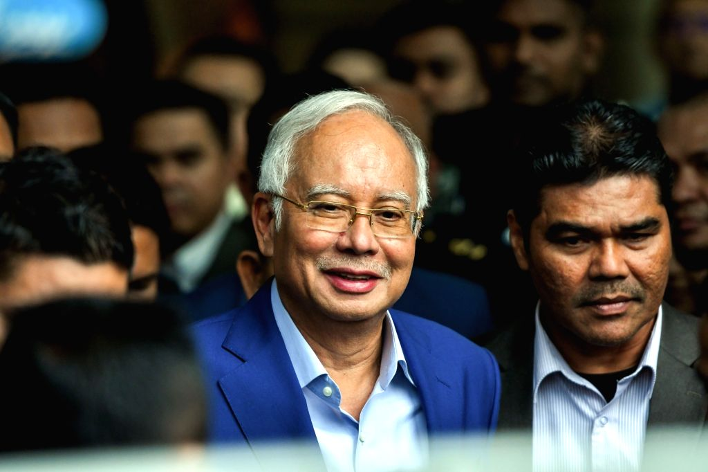 PUTRAJAYA, May 22, 2018 - Former Malaysian Prime Minister Najib Razak (L) leaves after being questioned at Malaysian Anti-Corruption Commission (MACC) headquarters in Putrajaya, Malaysia, May 22, ... - Najib Razak