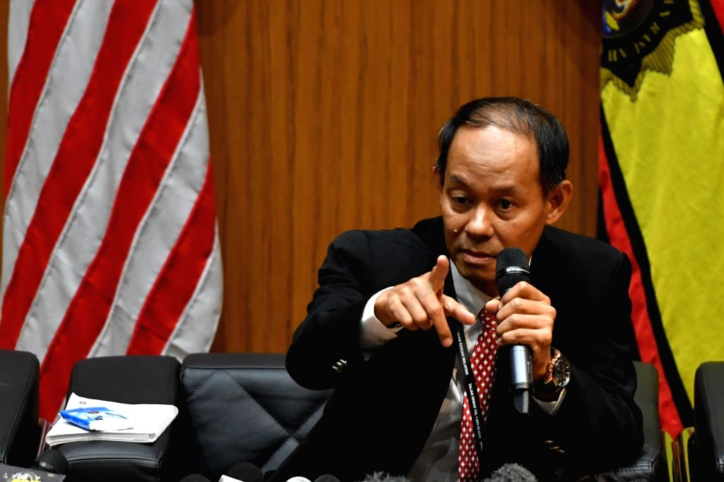 PUTRAJAYA, May 22, 2018 - Mohd Shukri Abdull, chief of the Malaysian Anti-Corruption Commission (MACC), talks to reporters at the MACC headquarters in Putrajaya May 22, 2018. Former Malaysian Prime ... - Najib Razak