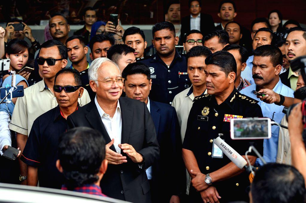 PUTRAJAYA, May 24, 2018 - Former Malaysian Prime Minister Najib Razak (L, front) leaves Malaysian Anti-Corruption Commission (MACC) headquarters in Putrajaya, Malaysia, May 24, 2018. Investigators ... - Najib Razak
