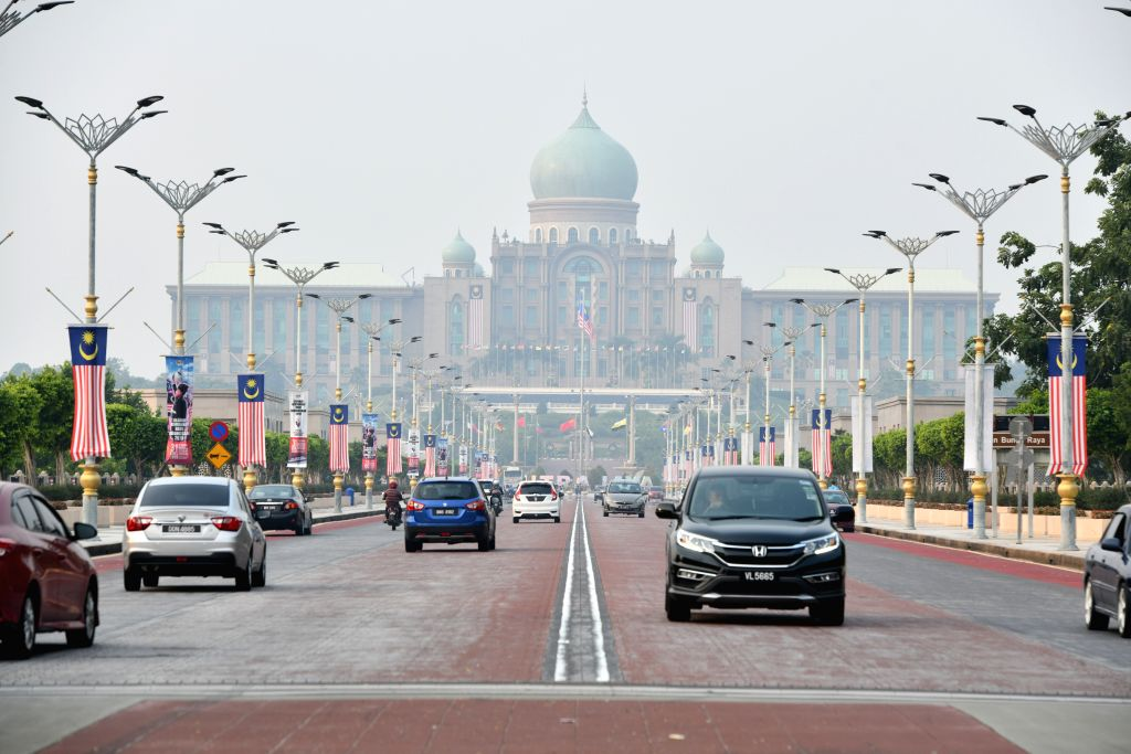 PUTRAJAYA, Sept. 12, 2019 - Photo taken on Sept. 12, 2019 shows the haze-shrouded Prime Minister's Office in Putrajaya, Malaysia. Malaysian authorities began cloud seeding operations on Thursday in ...