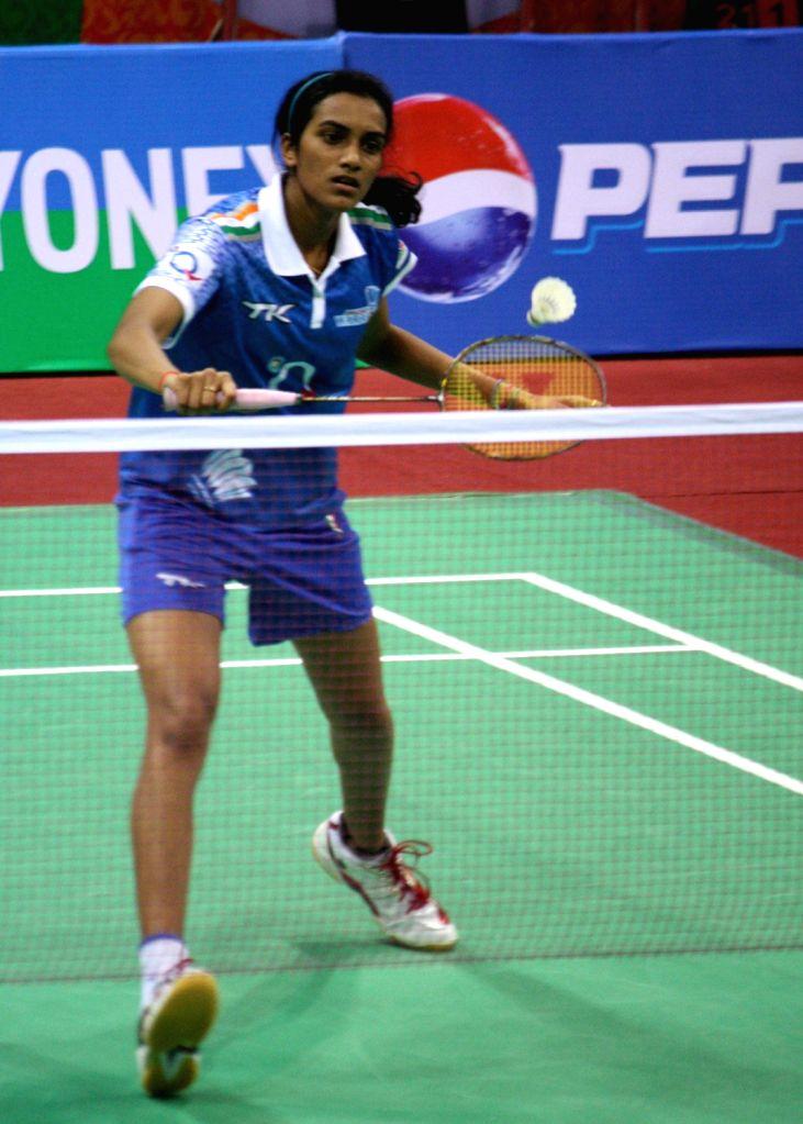 PV Sindhu of Awadhe Warriors against Saina Nehwal of Hyderabad Hotshots at the Indian Badminton League in New Delhi on August 15, 2013. (Photo::: IANS)