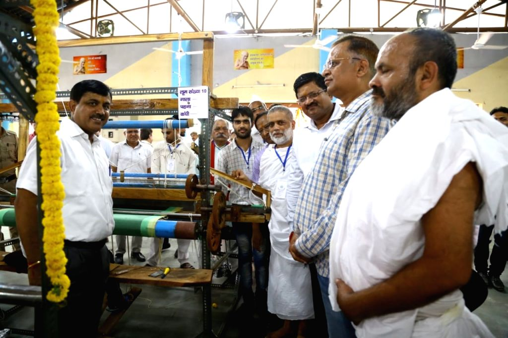 PWD Minister Satyendra Jain looks at the handloom machines in the Tihar jail. - Satyendra Jain