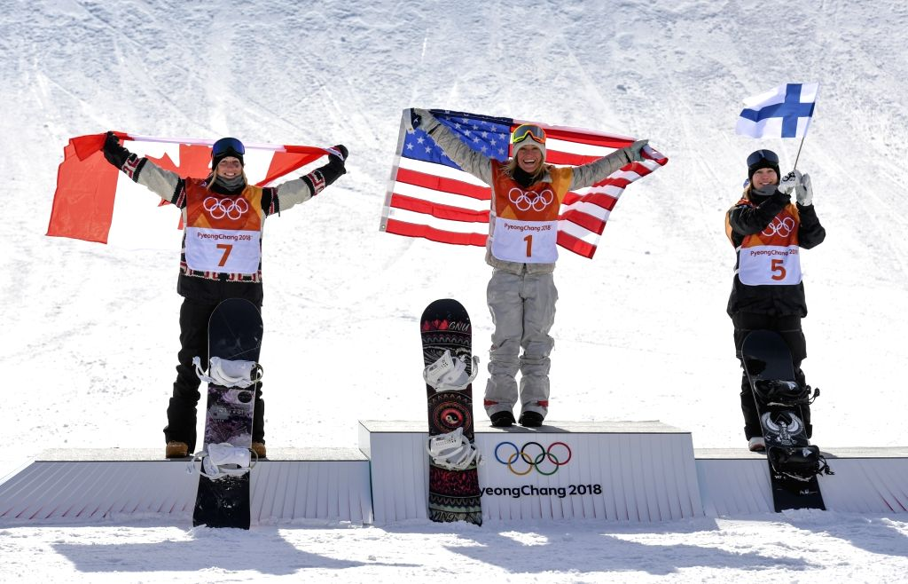 PYEONGCHANG, Feb. 12, 2018 - Champion Jamie Anderson of the United States (C), second-placed Laurie Blouin of Canada (L) and third-placed Enni Rukajarvi of Finland pose for group photos after the ...