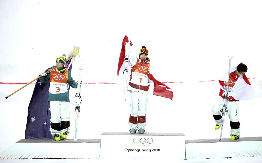 PYEONGCHANG, Feb. 12, 2018 - Champion Mikael Kingsbury from Canada (C), second-placed Matt Graham from Australia (L) and third-placed Daichi Hara from Japan celebrate during venue ceremony of men's ...