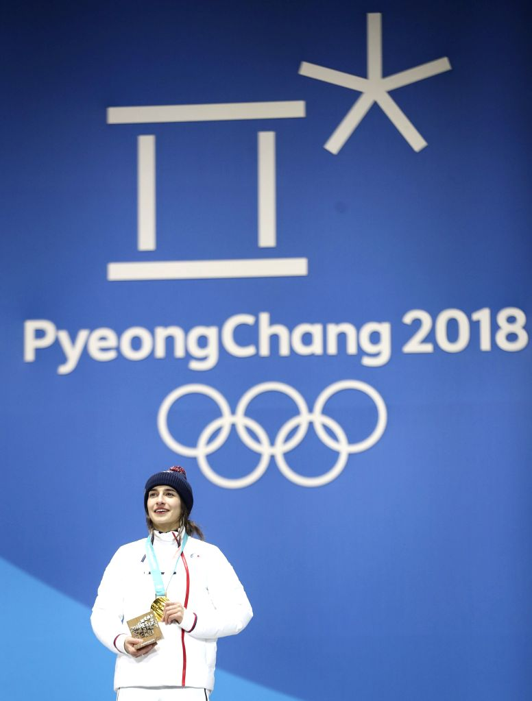 PYEONGCHANG, Feb. 12, 2018 - Champion Perrine Laffont from France poses for photos during medal ceremony for ladies' moguls event of freestyle skiing at 2018 PyeongChang Winter Olympic Games at the ...