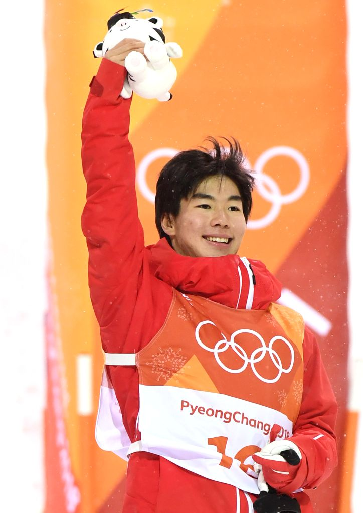 PYEONGCHANG, Feb. 12, 2018 - Daichi Hara from Japan celebrates during venue ceremony of men's moguls event of freestyle skiing at 2018 PyeongChang Winter Olympic Games at Phoenix Snow Park, ...