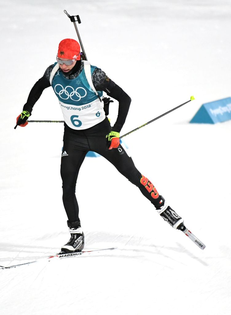 PYEONGCHANG, Feb. 12, 2018 - Germany's Benedikt Doll competes during men's 12.5km pursuit event of biathlon at 2018 PyeongChang Winter Olympic Games at Alpensia Biathlon Centre, Feb. 12, 2018. ...