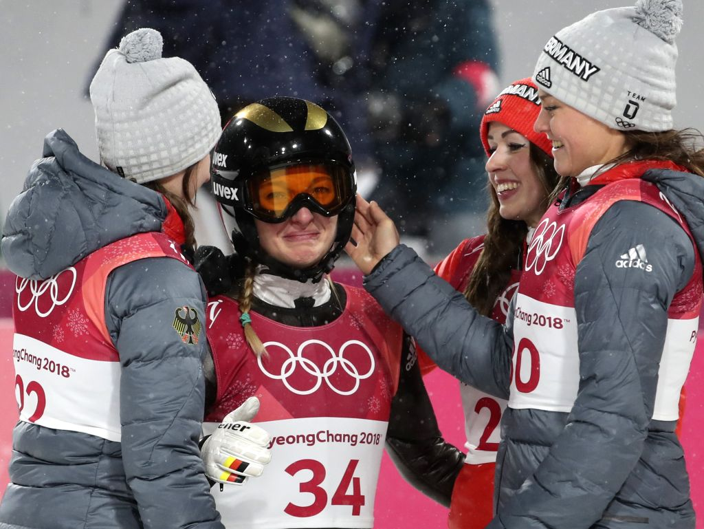 PYEONGCHANG, Feb. 12, 2018 - Katharina Althaus from Germany welcomes congratulation after finishing the ladies' normal hill individual event of ski jumping at 2018 PyeongChang Winter Olympic Games at ...