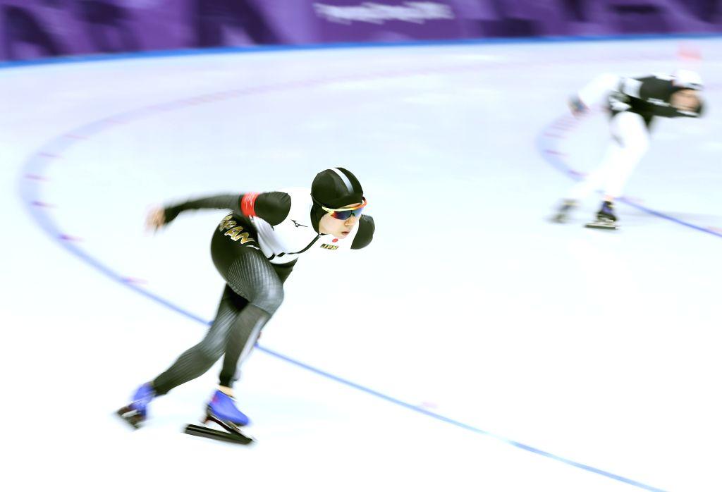 PYEONGCHANG, Feb. 12, 2018 - Miho Takagi (L) from Japan competes during the ladies' 1500m event of speed skating at 2018 PyeongChang Winter Olympic Games at Gangneung Oval, Feb. 12, 2018. Miho Takagi ...
