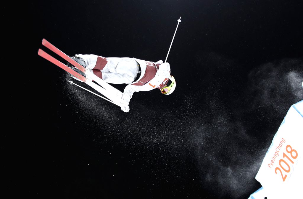 PYEONGCHANG, Feb. 12, 2018 - Mikael Kingsbury from Canada competes during men's moguls event of freestyle skiing at 2018 PyeongChang Winter Olympic Games at phoenix snow park, PyeongChang, South ...
