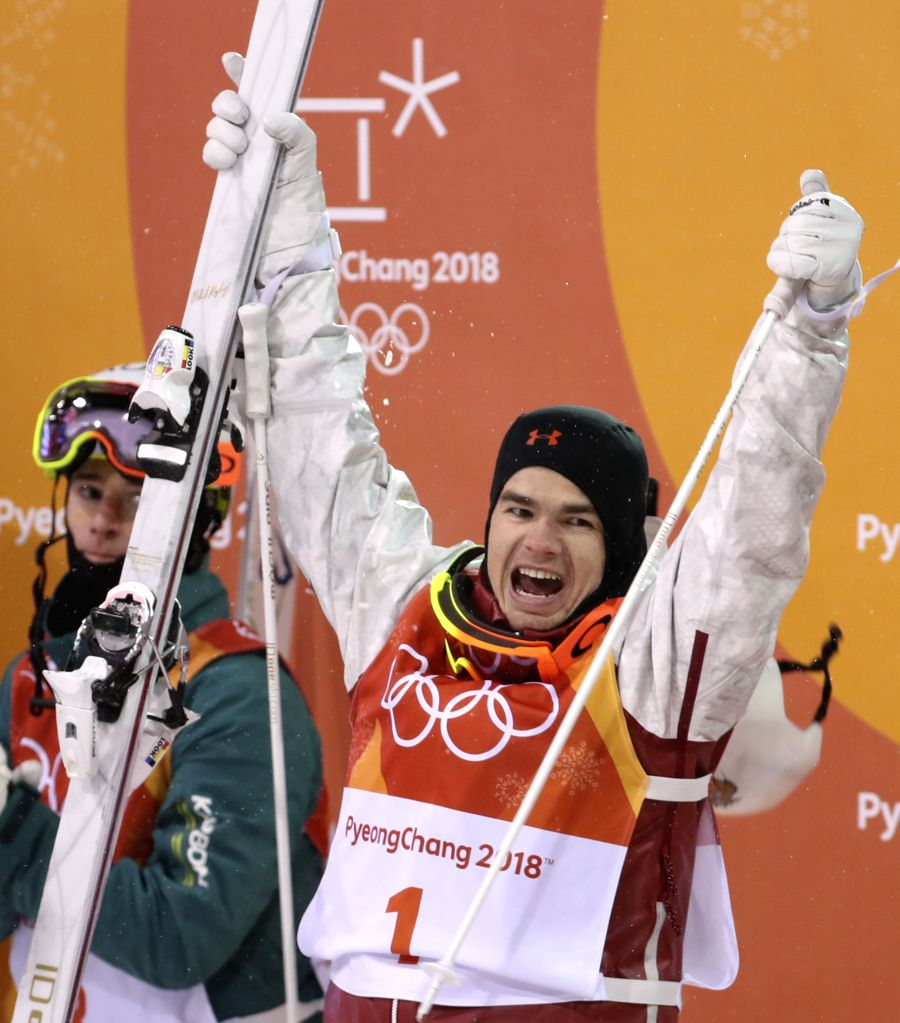 PYEONGCHANG, Feb. 12, 2018 - Mikael Kingsbury from Canada celebrates after finishing men's moguls event of freestyle skiing at 2018 PyeongChang Winter Olympic Games at phoenix snow park, PyeongChang, ...