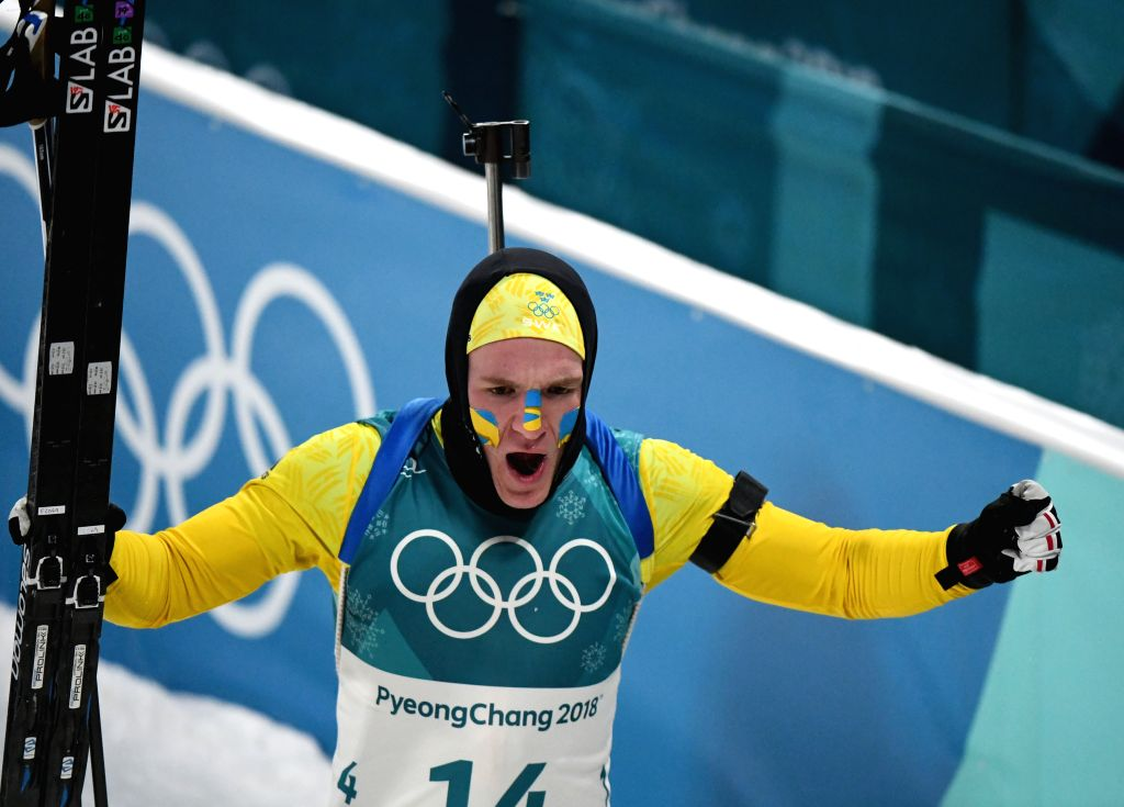 PYEONGCHANG, Feb. 12, 2018 - Sweden's Sebastian Samuelsson celebrates after finishing men's 12.5km pursuit event of biathlon at 2018 PyeongChang Winter Olympic Games at Alpensia Biathlon Centre, Feb. ...