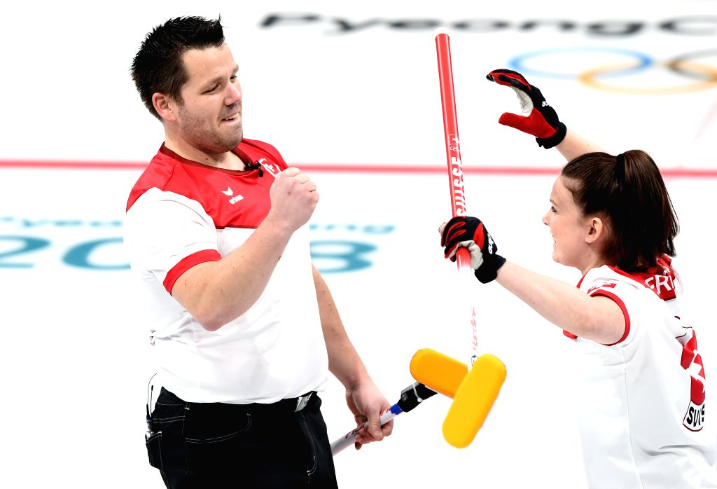 PYEONGCHANG, Feb. 12, 2018 - Switzerland's Jenny Perret (R) and Martin Rios celebrate during mixed doubles semi-final of curling at 2018 PyeongChang Winter Olympic Games at Gangneung Curling Centre, ...