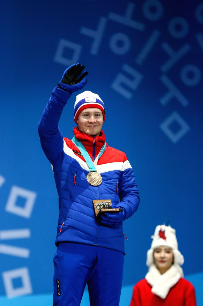 PYEONGCHANG, Feb. 12, 2018 - Third-placed Sverre Lunde Pedersen (L) from Norway reacts on the podium during medal ceremony for men's 5000m event of speed skating at 2018 PyeongChang Winter Olympic ...