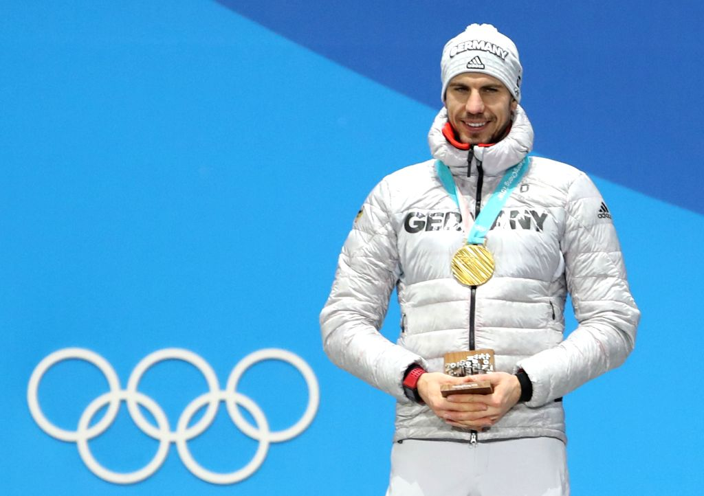 PYEONGCHANG, Feb. 13, 2018 - Champion Arnd Peiffer from Germany poses for photos during the medal ceremony of men's 10km sprint event of biathlon at 2018 PyeongChang Winter Olympic Games at the Medal ...