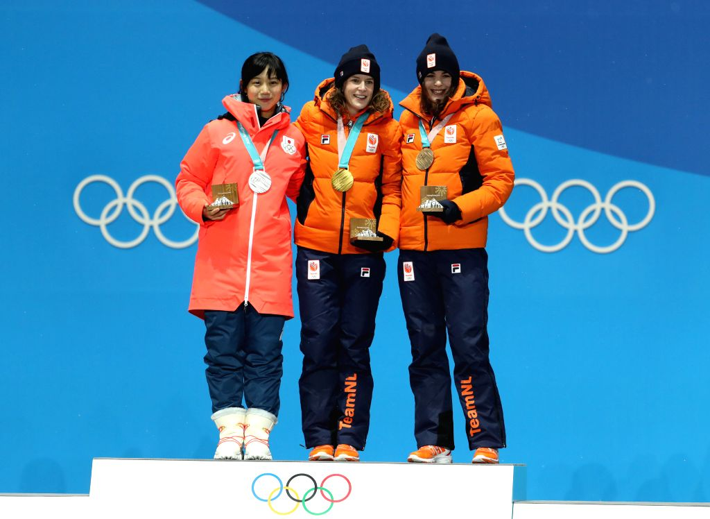 PYEONGCHANG, Feb. 13, 2018 - Champion Ireen Wust (C) from the Netherlands, second-placed Miho Takagi (L) from Japan and third-placed Marrit Leenstra from the Netherlands pose for photos during the ...