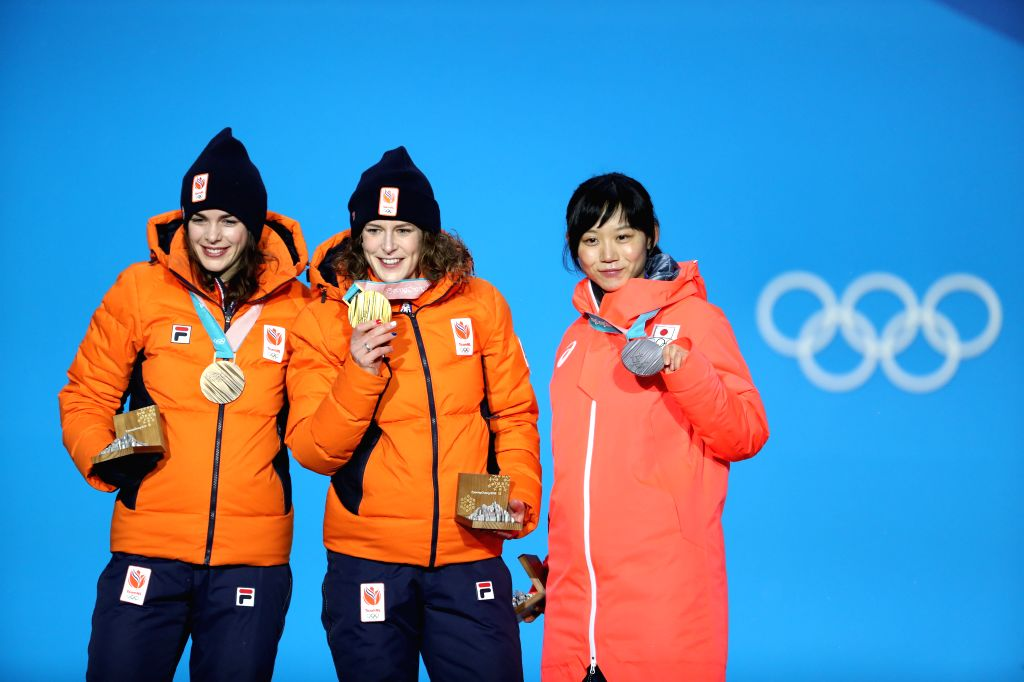 PYEONGCHANG, Feb. 13, 2018 - Champion Ireen Wust (C) from the Netherlands, second-placed Miho Takagi (R) from Japan and third-placed Marrit Leenstra from the Netherlands pose for photos during the ...