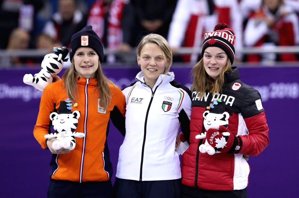 PYEONGCHANG, Feb. 13, 2018 - Champion Italy's Arianna Fontana (C), second-placed Yara Van Kerkhof from the Netherlands (L) and third-placed Canada's Kim Boutin pose for photos during the venue ...
