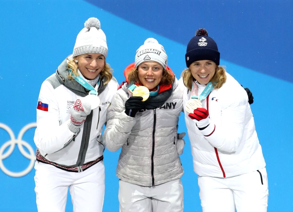 PYEONGCHANG, Feb. 13, 2018 - Champion Laura Dahlmeier (C) from Germany, second-placed Anastasiya Kuzmina (L) from Slovakia and third-placed Anais Bescond from France pose for photos during the medal ...