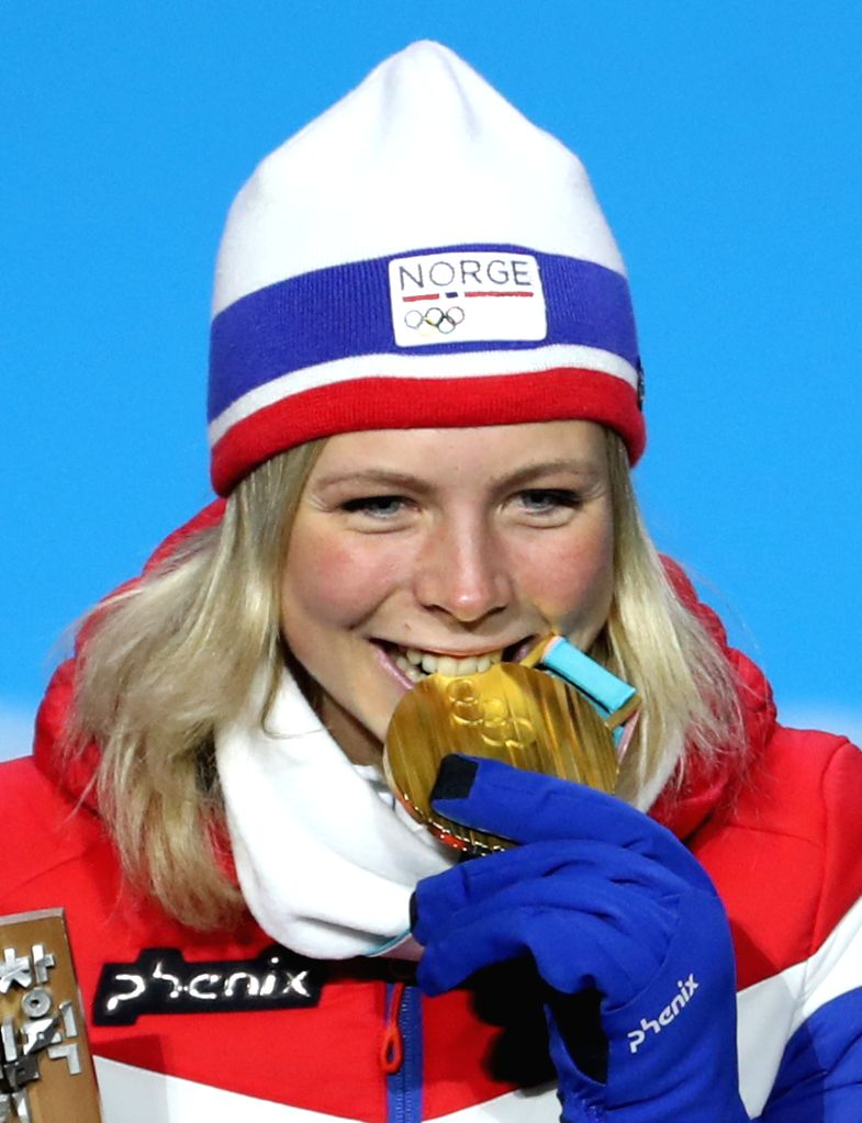 PYEONGCHANG, Feb. 13, 2018 - Champion Maren Lundby from Norway celebrates during the medal ceremony of ladies' normal hill individual event of ski jumping at 2018 PyeongChang Winter Olympic Games at ...