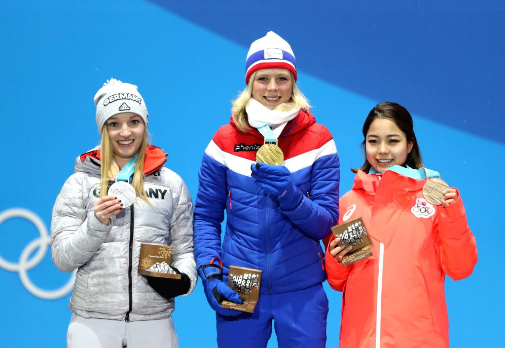 PYEONGCHANG, Feb. 13, 2018 - Champion Maren Lundby (C) from Norway, second-placed Katharina Althaus (L) from Germany and third-placed Sara Takanashi from Japan pose for photos during the medal ...