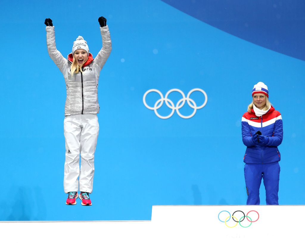 PYEONGCHANG, Feb. 13, 2018 - Champion Maren Lundby (R) from Norway and second-placed Katharina Althaus from Germany celebrate during the medal ceremony of ladies' normal hill individual event of ski ...