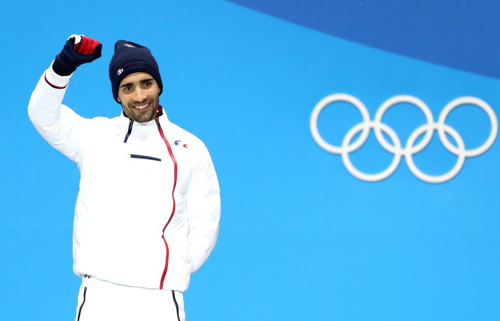 PYEONGCHANG, Feb. 13, 2018 - Champion Martin Fourcade from France poses for photos during medal ceremony of men's 12.5km pursuit event of biathlon at 2018 PyeongChang Winter Olympic Games at the ...