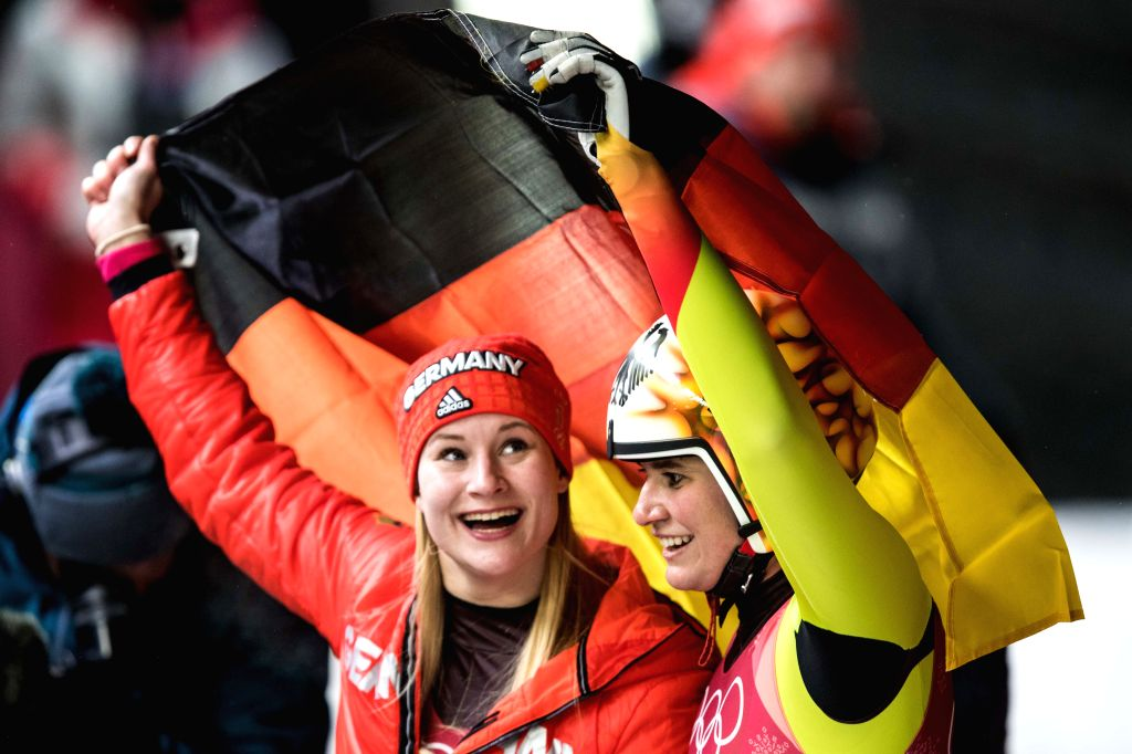 PYEONGCHANG, Feb. 13, 2018 - Champion Natalie Geisenberger (R) and second-placed Dajana Eitberger, both from Germany, celebrate after finishing women's singles event of luge at 2018 PyeongChang ...