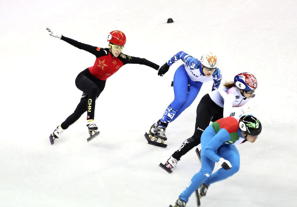 PYEONGCHANG, Feb. 13, 2018 - China's Fan Kexin (L1) tumbles during the ladies' 500m semi-final of short track speed skating at the Pyeongchang 2018 Winter Olympic Games at Gangneung Ice Arena, ...