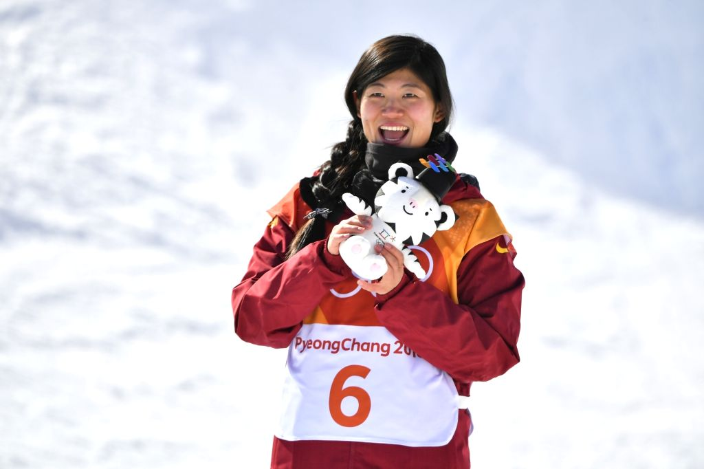 PYEONGCHANG, Feb. 13, 2018 - China's Liu Jiayu celebrates after ladies' halfpipe final of snowboard at the 2018 PyeongChang Winter Olympic Games at Phoenix Snow Park in PyeongChang, South Korea, on ...