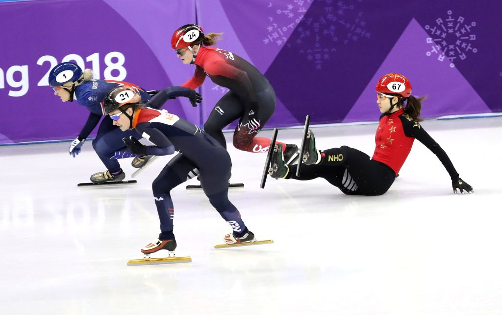PYEONGCHANG, Feb. 13, 2018 - China's Qu Chunyu (R1) falls during the ladies' 500m semi-final of short track speed skating at the Pyeongchang 2018 Winter Olympic Games at Gangneung Ice Arena, ...