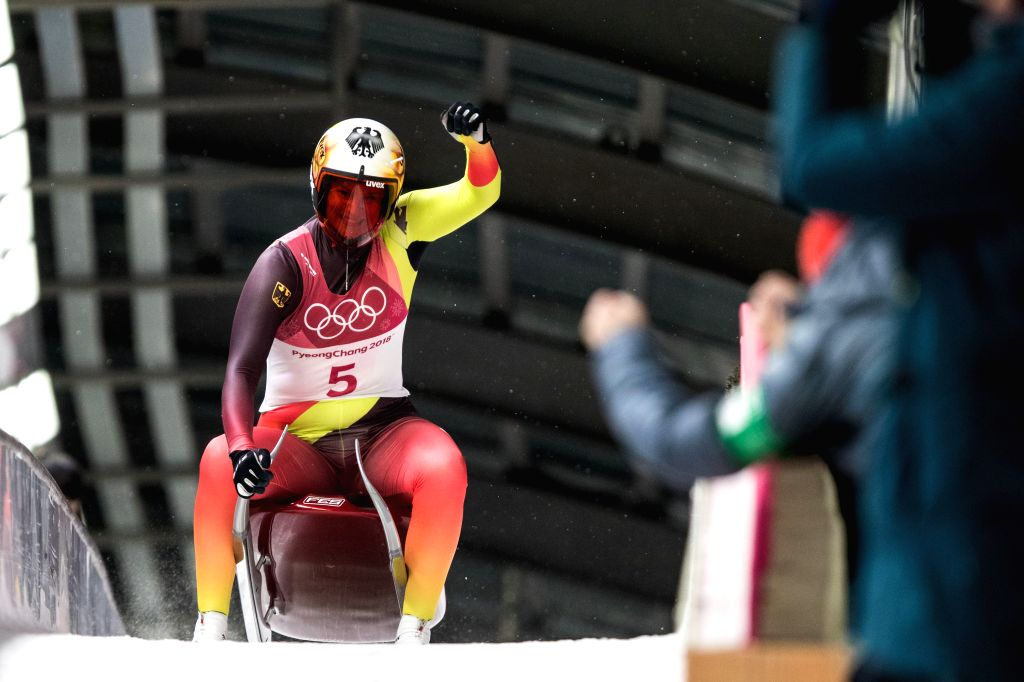PYEONGCHANG, Feb. 13, 2018 - Dajana Eitberger from Germany celebrates after crossing finishing line of women's singles event of luge at 2018 PyeongChang Winter Olympic Games at Olympic Sliding ...