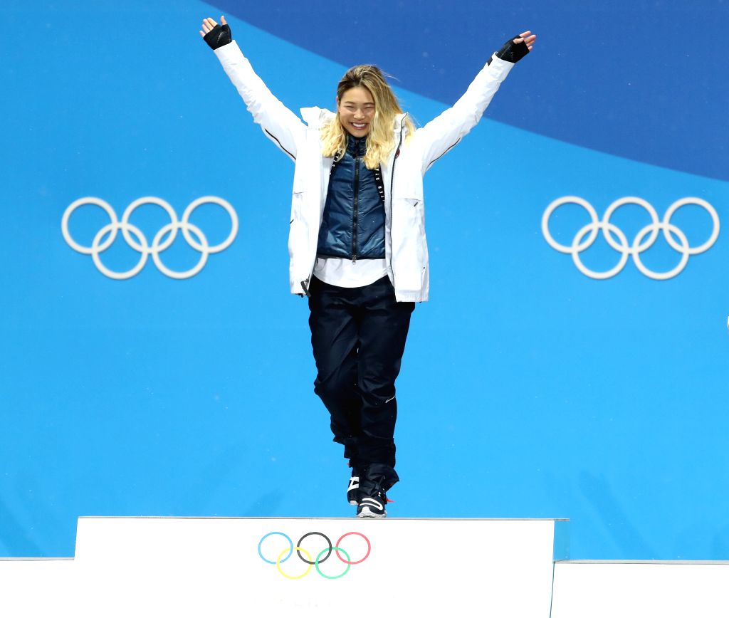PYEONGCHANG, Feb. 13, 2018 - Gold medalist Chloe Kim of the United States poses for photos during the medal ceremony of ladies' halfpipe finals of snowboard at the 2018 PyeongChang Winter Olympic ...