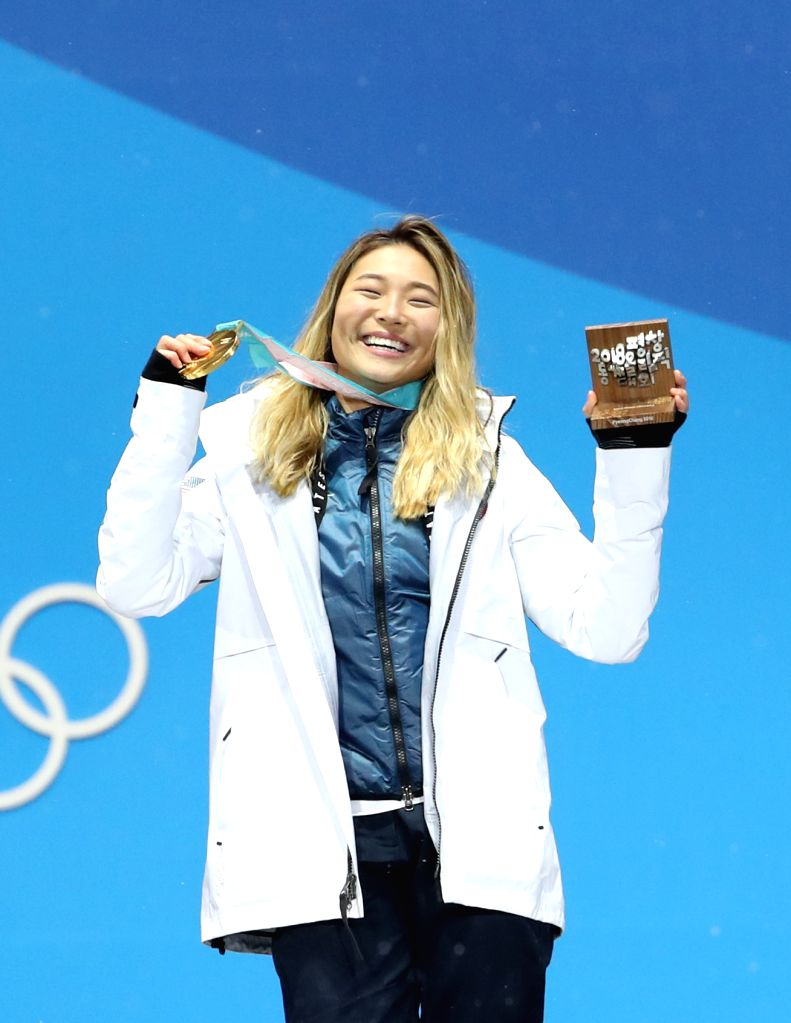 PYEONGCHANG, Feb. 13, 2018 - Gold medalist Chloe Kim from the United States poses for photos during the medal ceremony of ladies' halfpipe finals of snowboard at the 2018 PyeongChang Winter Olympic ...