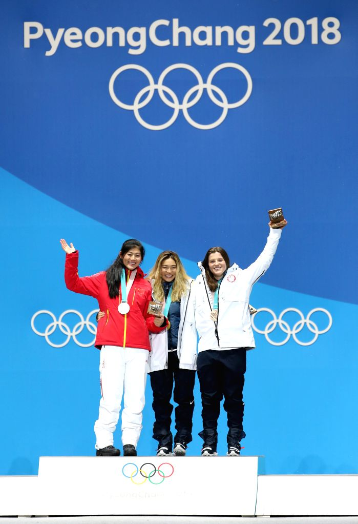 PYEONGCHANG, Feb. 13, 2018 - Gold medalist Chloe Kim (C) from the United States, silver medalist China's Liu Jiayu (L) and bronze medalist Arielle Gold of the United States pose for photos during the ...