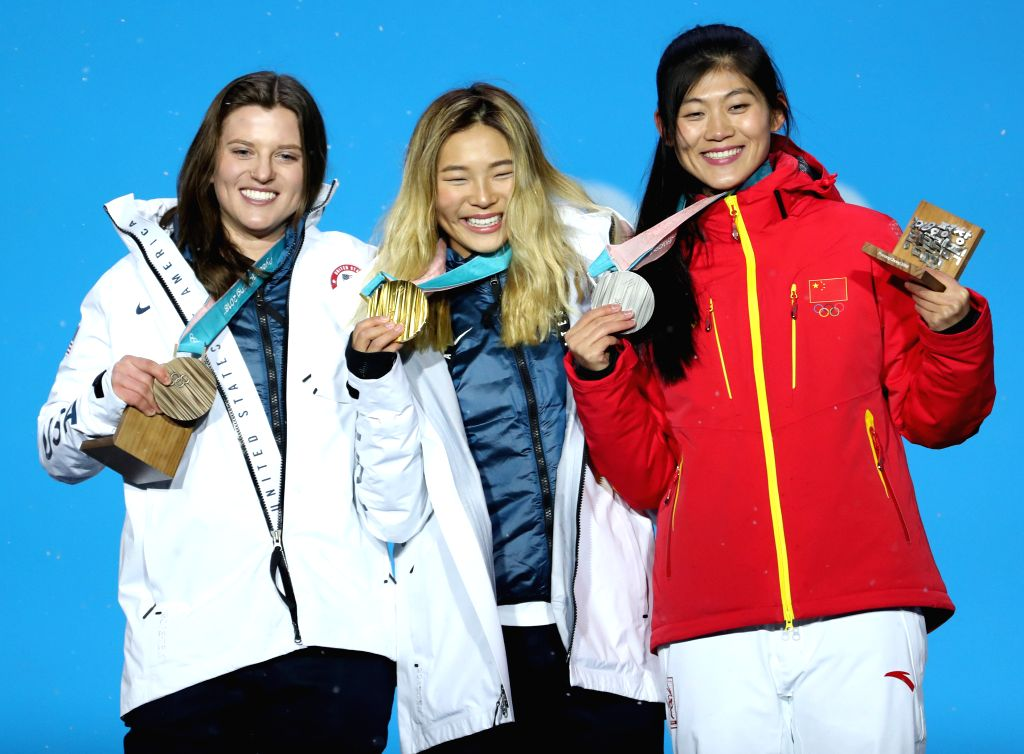 PYEONGCHANG, Feb. 13, 2018 - Gold medalist Chloe Kim (C) from the United States, silver medalist China's Liu Jiayu (R) and bronze medalist Arielle Gold of the United States pose for photos during the ...