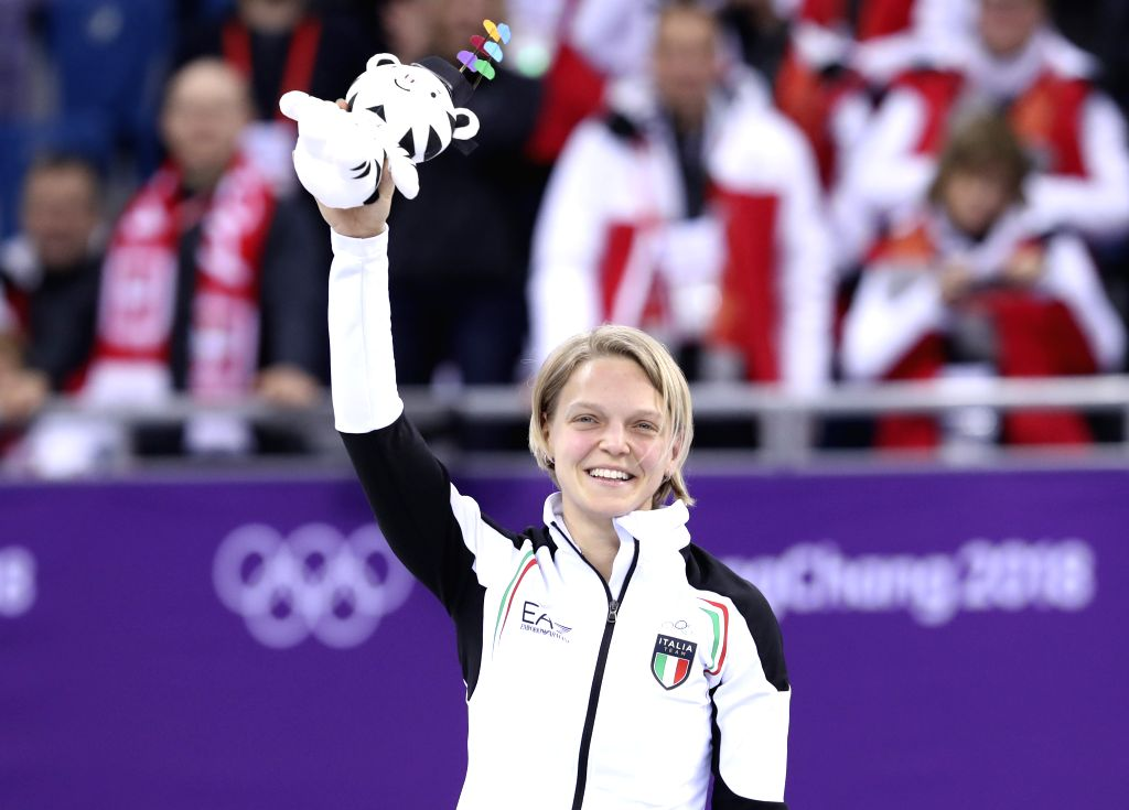PYEONGCHANG, Feb. 13, 2018 - Italy's Arianna Fontana celebrates during the venue ceremony of the ladies' 500m final of short track speed skating at the Pyeongchang 2018 Winter Olympic Games at ...